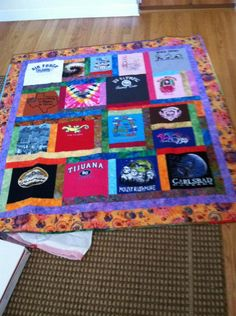Bought baby tee shirts on my trip around the US and my aunt made this awesome quilt from them!!