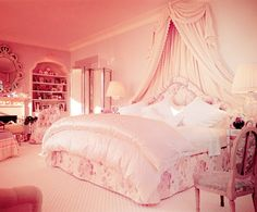 princess room-ok so our beds aren't this big, and neither is the room, but I love the fabric on the walls. so pretty :)