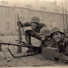 German soldiers pose for the camera early in WWII, location unknown.