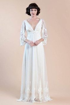 With a romantic plunging neckline.   36 Of The Most Effortlessly Beautiful Boho Wedding Dresses Ever