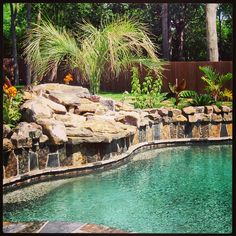 Boulder coping on a lagoon style radius gunite swimming pool custom designed and constructed by Preferred Pools Inc.