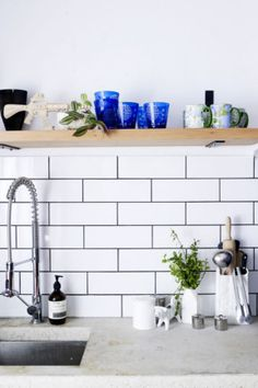 5. Display The kitchen's subway tiles, from National Tiles, were expertly installed by Nikki, a first-time tiler....