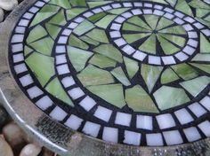 heat resistant stained glass handmade mosaic trivet or candle plate. *mosaic trivet is 8 in diameter  *made with hand cut stained glass  *grouted in