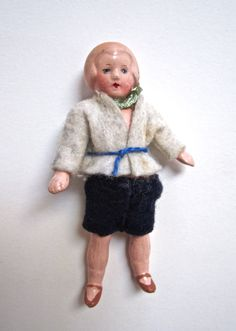 "This 3.5"" Composition Dollhouse Boy Doll was probably made by Hertwig or Limbach in Germany during the 1920's.  Available for $10 at http://www.uncannyartist.com/products/composition-dollhouse-doll."