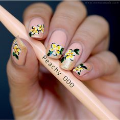 Beautiful hand painted floral peach and yellow nail art by @nailsbynemo using the Mitty Peachy 000 Nail Art Brush available in the U.S. at snailvinyls.com