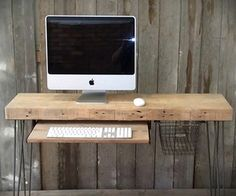 Urban Wood Goods... simple desk with mid century hairpin legs, locker basket drawer and slide out keyboard tray.