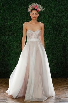 Watters Spring 2015 Collection -- the nude underlay on the skirt of this dress adds an extreme amount of sex-iness to this dress-- it looks like you're naked under that sheer! along with the corseted/bustier top half.... laws o laws! lol Not sure this would be a dress for ME though...