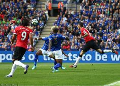 Manchester United winger Angel di Maria lifts the ball over Kasper Scmeichel with a deft chip to make it 2-0 to Manchester United at the King Power Stadium
