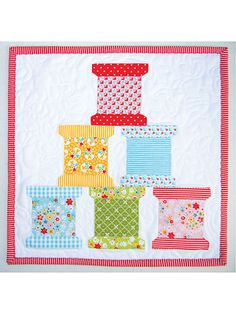 Hang them on a wall, stitch them together to create a fun sampler quilt, make them as place mats, stitch them up as unique pillows -- you can't go wrong! Featuring a pieced block, sewing machine, thread spools and a tomato pincushion, each template i...