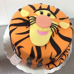 Pin for Later: Make It a Magical Day! 50 Wow-Worthy Disney Cakes Tigger-ific! Put a bounce in your birthday boy (or girl)'s step with this awesome orange Tigger cake. Source: Instagram user chefsilvanazanella