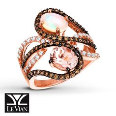 Swirls of luscious Chocolate Diamonds® beautifully showcase an oval morganite and an oval opal in this unique ring by Le Vian®. Vanilla Diamonds® provide the finishing touch and bring the total diamond weight to 7/8 carat. The ring is crafted in romantic Strawberry Gold®. Le Vian®. Discover the Legend. Diamond Total Carat Weight may range from .83 - .94 carats. Most natural gemstones pictured have been subject to an enhancement process or treatment (e.g. hea...