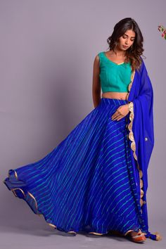 Royale blue full flared lehenga with green blouse and blue dupatta embellished with golden lace (ghera 8 mtr) fabric of lehenga is chiffon and dupatta is in georgette . Cotton Lehenga, Half Saree Lehenga, Lehenga Blouse, Silk Lehenga, Blue Lehenga, Anarkali, Sarees, Stylish Blouse Design, Stylish Dress Designs