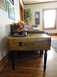 Such a cool idea!  An old suitcase made into a table!