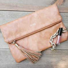 One of our all time favorite products that we carry ♡ embossed fold over clutch. #simplyembroidered