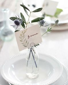 A lovely DIY name card and sprig of leaves.