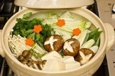 Shabu Shabu is Japanese hot pot with thinly sliced beef or pork dipped in citrus ponzu sauce, enjoy with napa cabbage, enoki mushrooms in kombu broth.