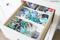 Genius nursery organization tips: Fold your child's clothes so that you can see them all at one glance, via Two Twenty One.