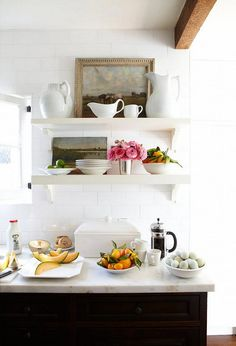 Love the layering in the shelves, with the pictures behind the crockery