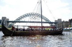 The Gaia replica Viking longship sails underneath the Millennium and Tyne Bridges on the Newcastle-Gateshead quayside on Sunday afternoon as part of the Olympic festival