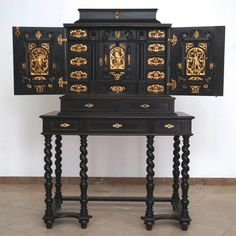 A South-German ebony veneer and gilded copper cabinet, 17th