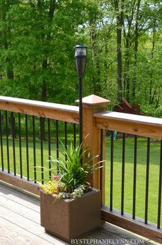 Outdoor Living Space Essentials | a sneak peek of the deck - bystephanielynn