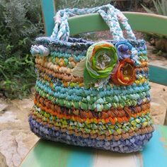 .love the colors of the rags they used to crochet this bag neat flowers too