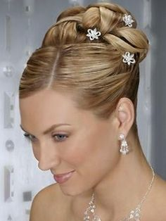 Classy Updos: Are you looking for a classy updo that would still dress up your appearance and suit the ceremonial atmosphere of your wedding? Then wedding buns as well as twists were made to please your needs. These old-school and old time Hollywood inspired hair styles would take you to a familiar field of hair styling as these won't require a similar effort as well as time to create them.     Still ask the help of your professional hair stylist as he/she would provide you with the best tricks to preserve the spotless look of your do all throughout the various phases of the wedding. Combine stylish buns and side buns with additional hair accessories as braids as these would further boost the dimension and A-list look of your tresses. Bring out the best of your features by juggling with volume as well as hair part and the curly or super-sleek texture of your strands.