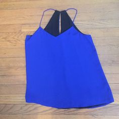 Reversible dress top Cobalt blue and black reversible Express blouse tank top. Razorback with spaghetti straps. Express Tops Blouses