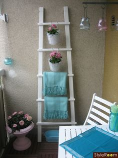 Shades of New Mexico.....the pueblo-style ladder could be painted any bright color.