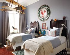 A children's room gets a bit of whimsy from a jumbo model airplane hanging from the ceiling. A globe and a vintage sign from Mexico add to the room's jet-setting appeal. 14 Rooms that Prove the Best Accessories Don't Come from a Home Store - ELLEDecor.com