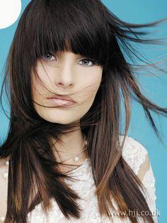 Dark chocolate with caramel peek a boo highlights on straight hair w/ bangs