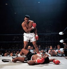 Muhammad Ali after first round knockout of Sonny Liston during World Heavyweight Title fight at St. Dominic's Arena in Lewiston, Maine