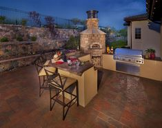 Your pizza oven can become the focal point of your outdoor kitchen. This cylindrical design is nicely tucked into the corner of this layout....