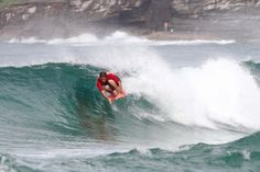Harley Ingleby single-finning on the nose during the 2012 Curly Maljam Pro. Photo  WozThatYou