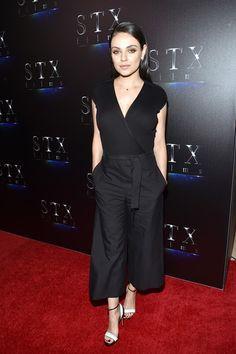 c0302e205ccf Spott - Mila Kunis looks stunning in her black jumpsuit by Brunello  Cucinelli