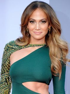 Toffee and honey highlights on Jennifer Lopez start from mid-length down, letting her test out a blonde spectrum without dealing with dark roots. keeps her hair as sexy as the rest of her look with loose curls and subtle highlights.Photo Credit: Kevork Djansezian/Getty Images, courtesy of iVillage - via StyleList