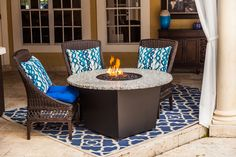 The Riviera 48'' round fire table by Firetainment, for cooking, dining and relaxing. #firetainment