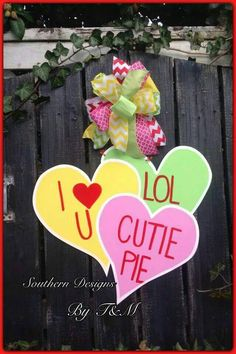 Conversation Hearts wooden door hanger,  Valentines Day decor by SouthernDesignsByTM on Etsy https://www.etsy.com/listing/219369306/conversation-hearts-wooden-door-hanger