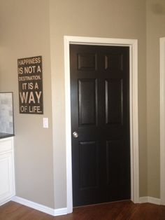 Black doors with white trim. Love. #doors #black #white trim #mixed... this is going to be the color of all the doors and hall way but we are doing black trim so they wont get dirty.