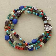 """Three strands of multicolored beads—coral, turquoise, garnet, lapis, prehnite and cognac quartz—fasten with an etched sterling silver heart button. Exclusive. 7-1/2""""L."""
