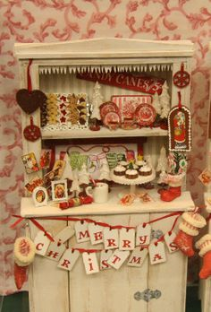 Christmas cabinet in 1:12 scale decorated for Christmas by Babs Raftery with dishes and food - Photo Copyright 2011 Lesley Shepherd
