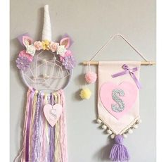 Make your little girls dreams come true, whilst catching the bad ones, with this one of a kind Unicorn Dream Catcher and Pennant set and add that personal touch to your childs room. Measurements: 6inch hoop/25-30cm tassel length These are unique made to order items and can be personalised to perfectly colour match your little girls bedroom - just pop a note on your order with your required initial and colour preferences along with the choice of plain, webbed or heart centre on the drea...
