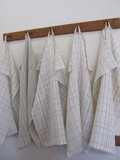 pindle and shuttle; Linen Towels Handwoven in 2/40 natural linen yarns, including the hanging tabs.
