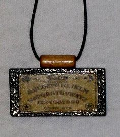 Ouija Board domino pendant altered art - http://www.tutorfrog.com/ouija-board-domino-pendant-altered-art/  #Toys #cooltoys
