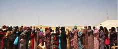 Iraqi women displaced from Mosul by extremist fighters stand on a food line in Khazair, Iraq. (Photo: Spencer Platt/Getty Images)