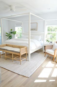 modern coastal bedroom decor with modern four poster bed and white bedding, neutral bedroom with jute rug and white walls, all white bedroom decor, cottage bedroom decor Cottage Bedroom Decor, Coastal Master Bedroom, White Bedroom Decor, Coastal Bedrooms, Master Bedroom Design, Home Bedroom, Modern Bedroom, Bedroom Ideas, Contemporary Bedroom