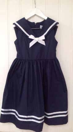 Girls Classic navy sailor dress party holiday dress at www.littleandpinkboutique.co.uk Navy Sailor, Sailor Dress, Boutique Party Dresses, Holiday Dresses, Dress Party, Sequins, Rompers, Classic, Girls