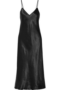 Vince's dress is made from satin and cut in a classic slip silhouette. It has delicate straps, a flattering V-neckline and elegant midi hem. We like it best paired with slides.