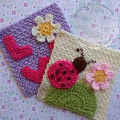 A pair of cute and whimsical mini afghan squares with a Ladybird and Flower motif on one square and the word LOVE on another.