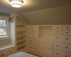 In an odd shape room like this using the wall space is better than lots of furniture which takes up space and makes the room look cluttered.